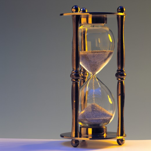 Stock Photo: 4285-5958 BRASS HOURGLASS IN GOLDEN MOOD.