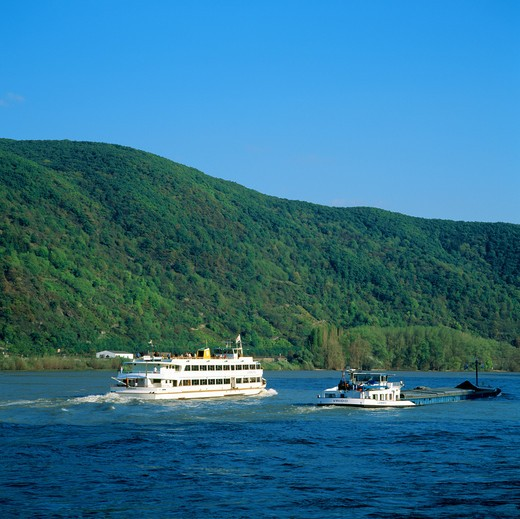 CRUISE BOAT AND BARGE ON THE RHINE RIVER RHINE VALLEY GERMANY : Stock Photo