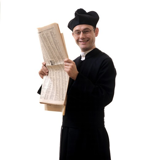 Stock Photo: 4285-6548 LAUGHING CATHOLIC PRIEST WITH A FINANCIAL NEWSPAPER
