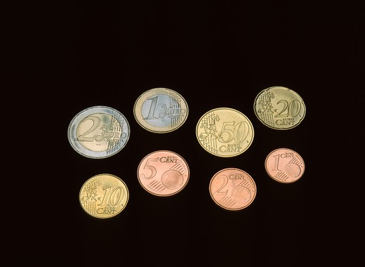 Stock Photo: 4285-6863 THE 8 EURO AND EURO CENT EUROPEAN CURRENCY COINS ON A BLACK BACKGROUND