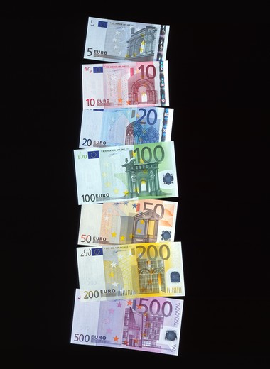 Stock Photo: 4285-6864 THE 7 EURO EUROPEAN CURRENCY BANKNOTES ON A BLACK BACKGROUND