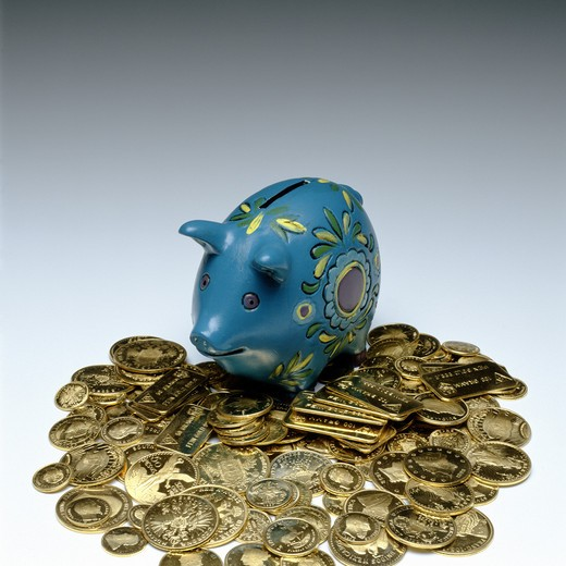 BLUE PIGGY BANK AND ANCIENT GOLD COINS : Stock Photo