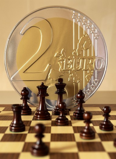 Stock Photo: 4285-7154 GAME OF CHESS AND A GIANT  2 EURO COIN MODEL
