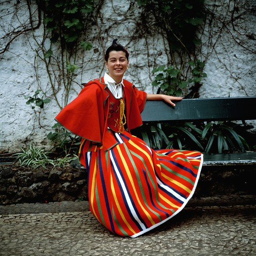 Stock Photo: 4285-7219 SGM SQUARE PORTUGAL MADEIRA ISLAND GIRL WITH TRADITIONAL MADEIRAN COSTUME ON BENCH