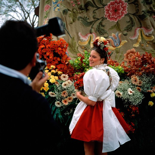 Stock Photo: 4285-7315 SGM SQUARE PORTUGAL MADEIRA ISLAND FUNCHAL SPRING FLOWER FESTIVAL YOUNG WOMAN POSING FOR THE CAMERA