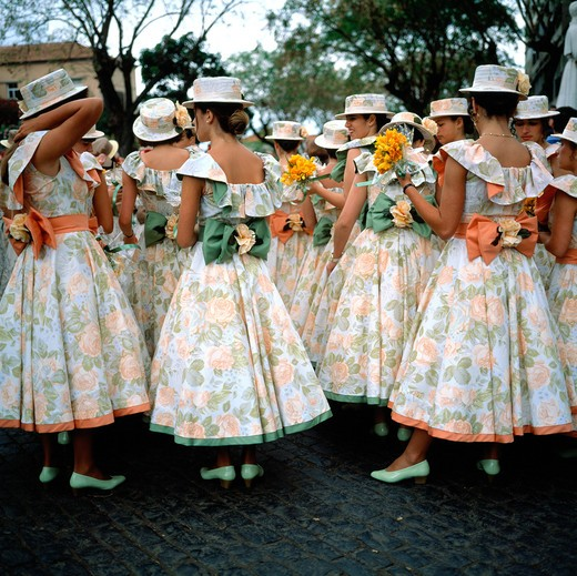 Stock Photo: 4285-7322 SGM SQUARE PORTUGAL MADEIRA ISLAND FUNCHAL SPRING FLOWER FESTIVAL GROUP OF YOUNG WOMEN WITH FLOWERY DRESS AND HAT