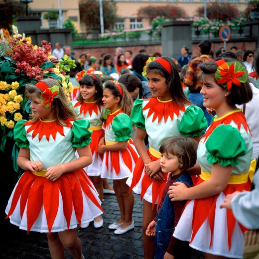 Stock Photo: 4285-7334 SGM SQUARE PORTUGAL MADEIRA ISLAND FUNCHAL SPRING FLOWER FESTIVAL GROUP OF LITTLE GIRLS WITH GREEN WHITE AND RED DRESS