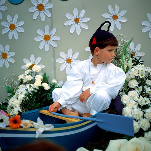 Stock Photo: 4285-7348 SGM SQUARE PORTUGAL MADEIRA ISLAND FUNCHAL SPRING FLOWER FESTIVAL LITTLE BOY ON A FLOAT