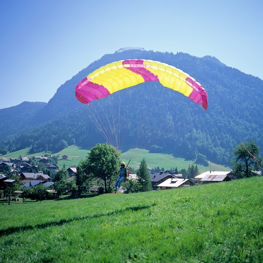 FRANCE FRENCH ALPS SAVOIE MORZINE RESORT PARAGLIDER LANDING : Stock Photo