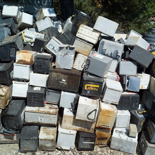 CAR AND TRUCK BATTERIES AT RUBBISH DUMP SITE PROVENCE FRANCE : Stock Photo