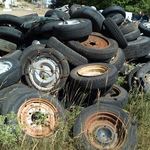 Stock Photo: 4285-8288 DISCARTED CAR WHEELS AND TIRES AT RUBBISH DUMP SITE PROVENCE FRANCE