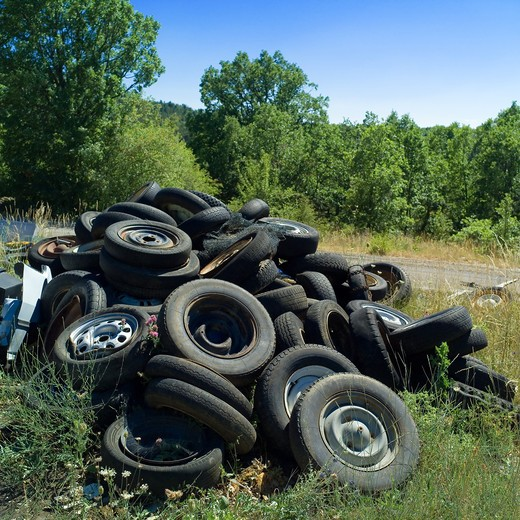 DISCARTED CAR WHEELS AND TIRES AT RUBBISH DUMP SITE PROVENCE FRANCE : Stock Photo