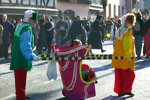 Stock Photo: 4285-8408 FRANCE ALSACE STRASBOURG CARNIVAL PARADE COUPLE AND LITTLE GIRL IN A SEDAN CHAIR