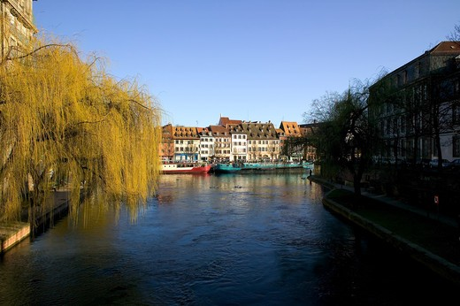 FRANCE ALSACE STRASBOURGQUAI DES PECHEURS WATERFRONT HOUSES QUAY AND BARGES AND ILL RIVER : Stock Photo