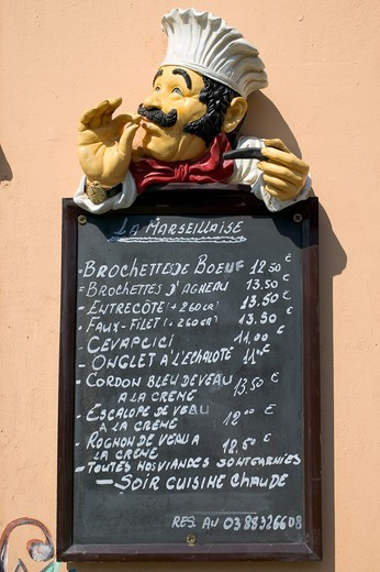 Stock Photo: 4285-8480 FRANCE ALSACE STRASBOURG OUTSIDE FUNNY RESTAURANT'S MENU WITH A CHEF FIGURINE
