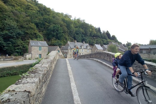 FRANCE BRITTANY LEHON VILLAGE BIKERS ON ANCIENT BRIDGE : Stock Photo