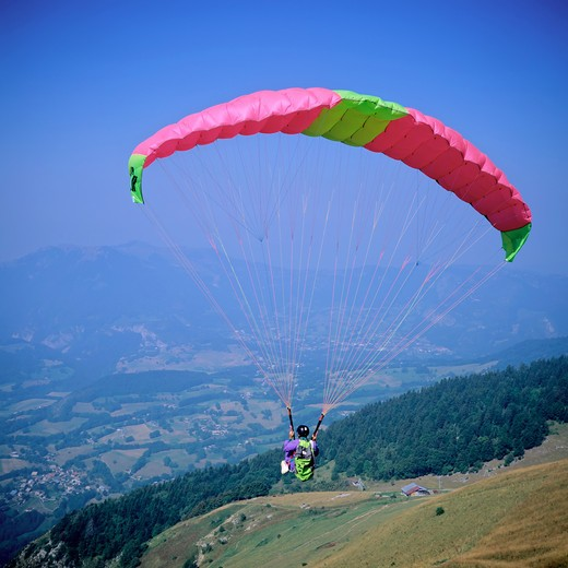 Stock Photo: 4285-8672 FRANCE FRENCH ALPS SAVOIE PARAGLIDER IN FLIGHT