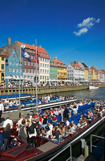 Stock Photo: 4285-9168 TOURIST TOUR BOATS DEPARTURE PIER ANCIENT HOUSES AND WATERFRONT CAFE TERRACES NYHAVN NEW HARBOUR COPENHAGEN DENMARK