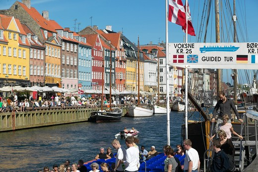 Stock Photo: 4285-9210 TOURIST TOUR BOAT DEPARTURE PIER ANCIENT HOUSES AND MOORED SAILBOATS NYHAVN NEW HARBOUR COPENHAGEN DENMARK