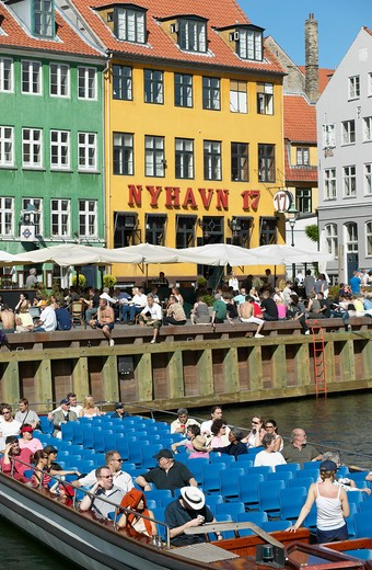 Stock Photo: 4285-9211 TOURIST TOUR BOAT ANCIENT HOUSES AND WATERFRONT CAFE TERRACE NYHAVN NEW HARBOUR COPENHAGEN DENMARK