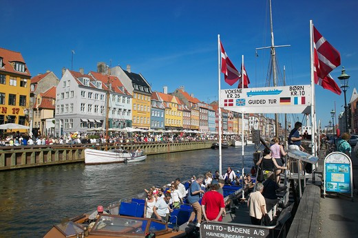 Stock Photo: 4285-9216 TOURIST TOUR BOAT DEPARTURE PIER SAILBOAT ANCIENT HOUSES AND WATERFRONT CAFE TERRACES NYHAVN NEW HARBOUR COPENHAGEN DENMARK