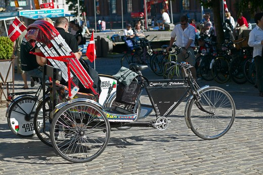 Stock Photo: 4285-9240 RICKSHAW TAXI ON THE WATERFRONT NYHAVN HARBOUR COPENHAGEN DENMARK