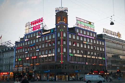 BUILDING WITH GIANT THERMOMETER AT DUSK RADHUSPLADSEN TOWN HALL SQUARE COPENHAGEN DENMARK : Stock Photo