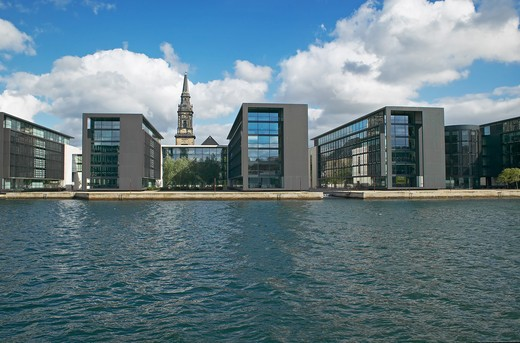 NORDEA BANK OFFICE BUILDINGS BUILT BY HENING LARSENAND CHRISTIAN'S CHURCH COPENHAGEN DENMARK : Stock Photo