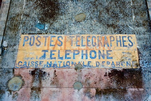 ANCIENT POST OFFICE TELEGRAPH AND TELEPHONE SIGN MENERBES PROVENCE FRANCE : Stock Photo