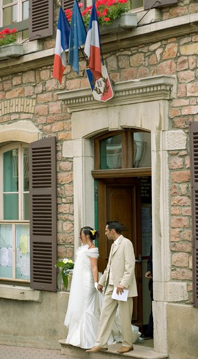 Stock Photo: 4285-9749 BRIDE AND GROOM IN FRONT OF TOWN HALL JULIENAS BEAUJOLAIS WINE COUNTRY RHONE VALLEY FRANCE