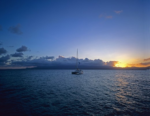 Stock Photo: 4285-9897 SAILBOAT CLOUDS AND SUNSET GUADELOUPE FRENCH WEST INDIES