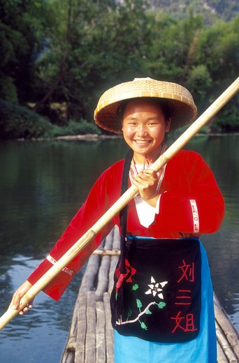 Stock Photo: 4285R-24956 China, Guilin, Li River, Girl Rowing