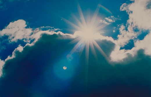 Sunrays through clouds : Stock Photo