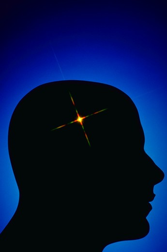 Stock Photo: 4286-16334 Silhouette of head with starburst