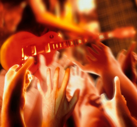 Rock star playing for crowd. : Stock Photo
