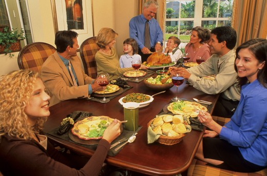 Stock Photo: 4286-17255 Three generations of family gathering for a large meal.
