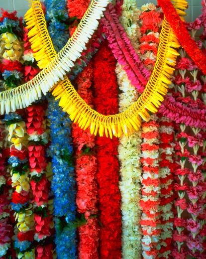 Stock Photo: 4286-18813 Colorful leis made of tropical flowers hanging on display, Hawaii.
