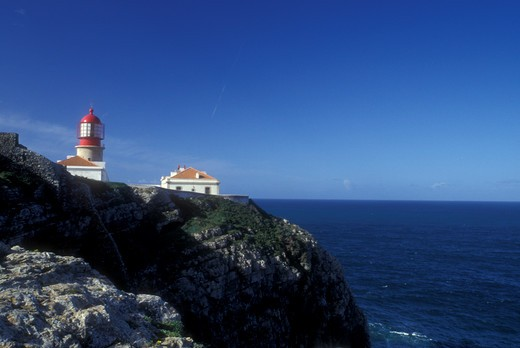 Portugal, Algarve, Lighthouse at Cabo de Sao Vincente along Algarve Coast of the Atlantic Ocean, Europe's south-westernmost point. : Stock Photo