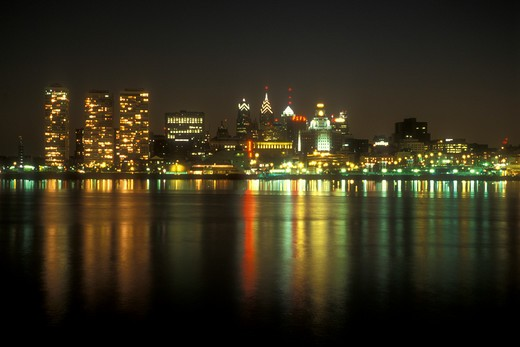 Philadelphia, skyline, Pennsylvania, The illuminated skyline of downtown Philadelphia reflects in the calm waters of the Delaware River in the evening, Pennsylvania. : Stock Photo