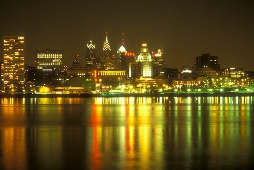 Stock Photo: 4286-19227 Philadelphia, skyline, Pennsylvania, The illuminated skyline of downtown Philadelphia reflects in the calm waters of the Delaware River in the evening, Pennsylvania.