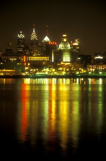 Stock Photo: 4286-19228 skyline, Philadelphia, Pennsylvania, The illuminated skyline of downtown Philadelphia reflects in the calm waters of the Delaware River in the evening, Pennsylvania.