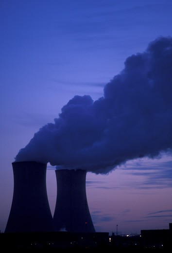 Stock Photo: 4286-19338 nuclear power plant, Pennsylvania, Steam rises from the cooling towers of the Philadelphia Electric Co. nuclear power plant against a dark blue sky in Limerick in the evening.