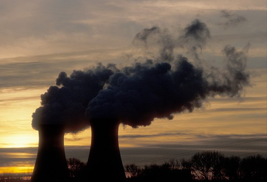 Stock Photo: 4286-19340 nuclear power plant, sunrise, sunset, Pennsylvania, Steam rises from the cooling towers of the Philadelphia Electric Co. nuclear power plant in Limerick at sunset.