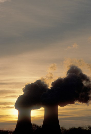 Stock Photo: 4286-19341 nuclear power plant, sunrise, sunset, Pennsylvania, Steam rises from the cooling towers of the Philadelphia Electric Co. nuclear power plant in Limerick at sunset.