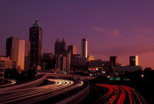 Stock Photo: 4286-19481 Atlanta, downtown skyline, Georgia, Skyline of downtown Atlanta and streaks of car lights on Downtown Connector Interstate I-85/I-75 from North Avenue at sunset in the state of Georgia.