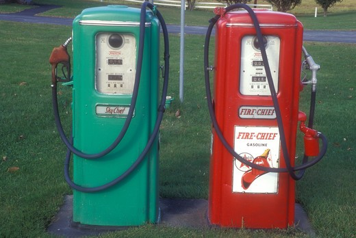 gas pumps, antique, collectibles, A red and green pair of Texaco gas pumps stand outside a garage in Berlin in Washington County in the state of Vermont. : Stock Photo