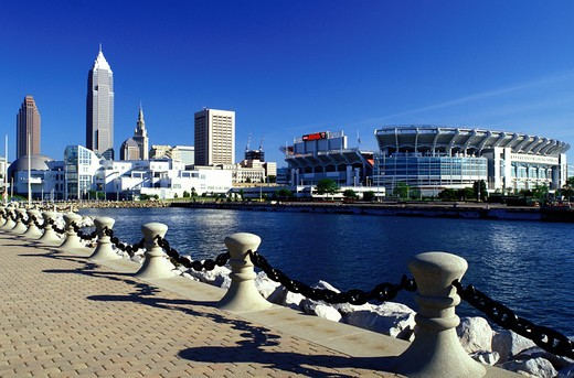 Cleveland, OH, Ohio, Skyline of downtown Cleveland and Cleveland Browns Stadium along the waterfront of North Coast Harbor. : Stock Photo