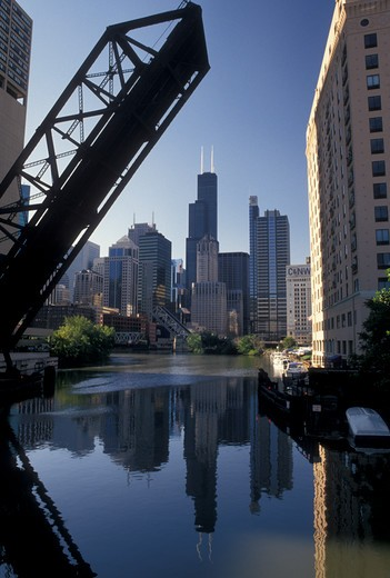 Stock Photo: 4286-20105 drawbridge, skyline, Chicago, IL, Illinois, Chicago River, A drawbridge in the up position shows the skyline of downtown Chicago reflecting in the Chicago River.