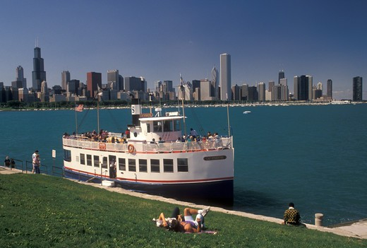 Stock Photo: 4286-20116 tour boat, Chicago Harbor, Chicago, IL, Lake Michigan, Illinois, Sightseeing tour boat loading passengers in Chicago Harbor. View of downtown skyline from the Lakeshore in Chicago.