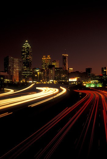 Stock Photo: 4286-20178 traffic, road, Atlanta, GA, skyline, Georgia, Traffic lights streak on I-75/I-85 at sunset and view of the skyline of downtown Atlanta.